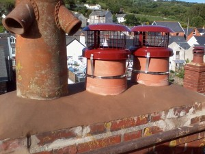 Top layers of loose bricks removed,re repointed.New pots fitted and cowls fitted to working chimneys.