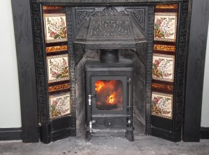 This little stove is a great example of what will fit into a traditional Victorian insert. The insert was removed,the back cut off and with some alterations to the fireplace the stove was fitted with a liner.This one produces 4.9kw and is multi fuel.