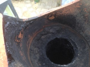 Broken Chimney pot and tarred up liner allowing rain to enter and mix with soot causing corrosion