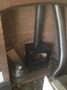 Stove placed and liner down the chimney.